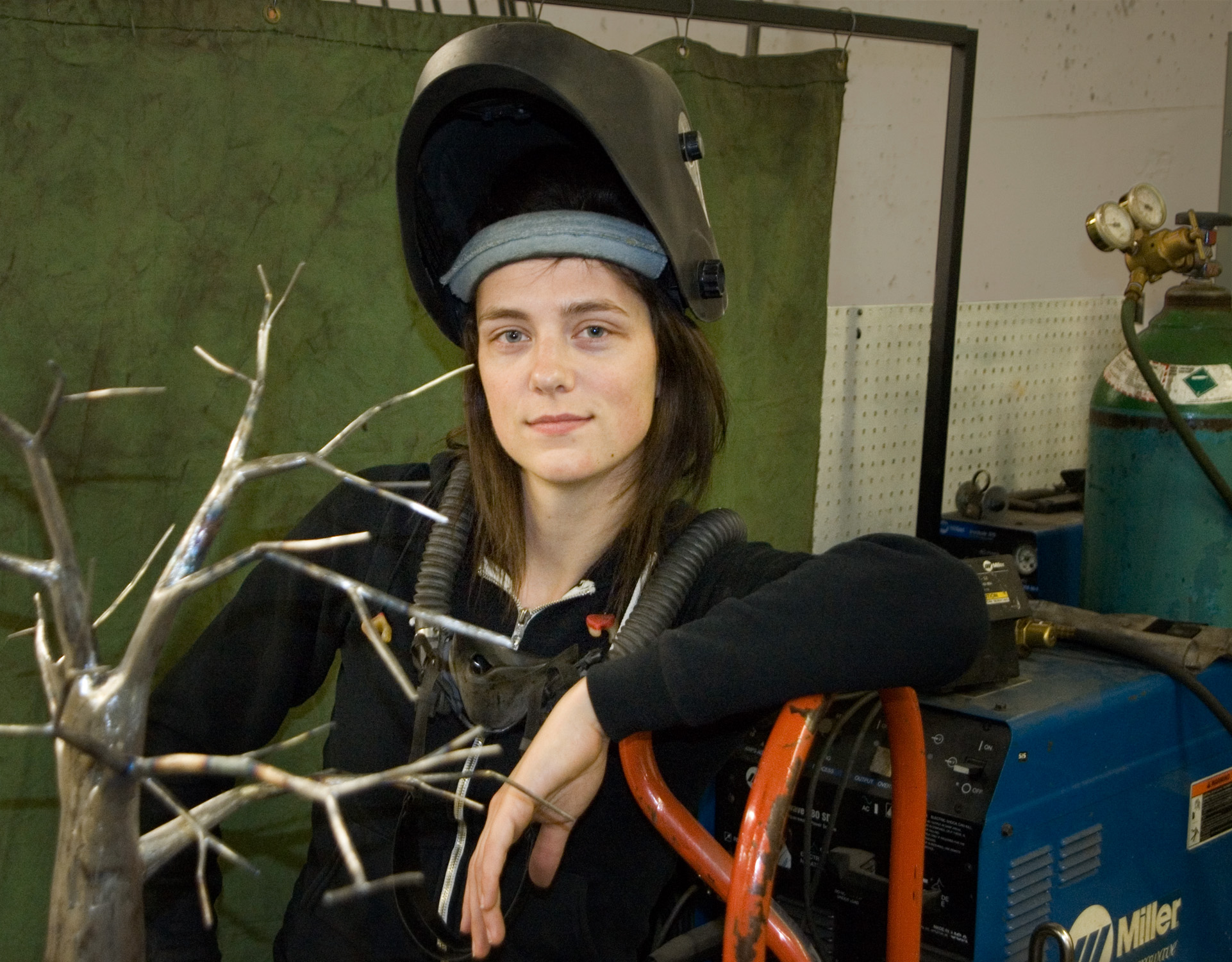 Sage working on bird cage sculpture